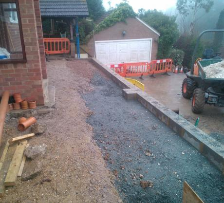 Retaining wall construction in Maidstone, previous wall failed as it didnt take into account the weight of the House