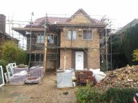 two storey extension with loft conversion and single sorey rear extension by DKM Consultants